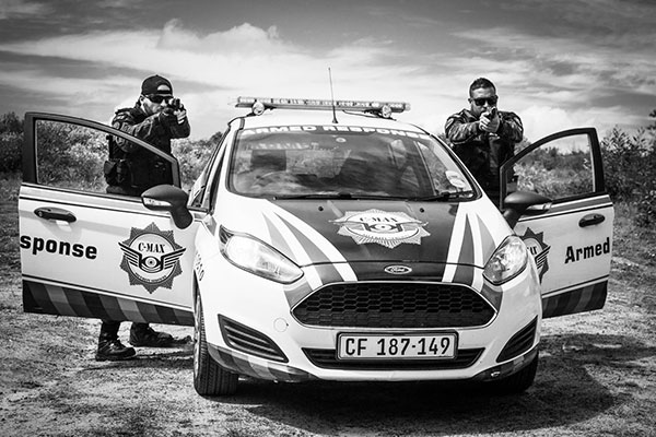2 security Guards next to their vehicle